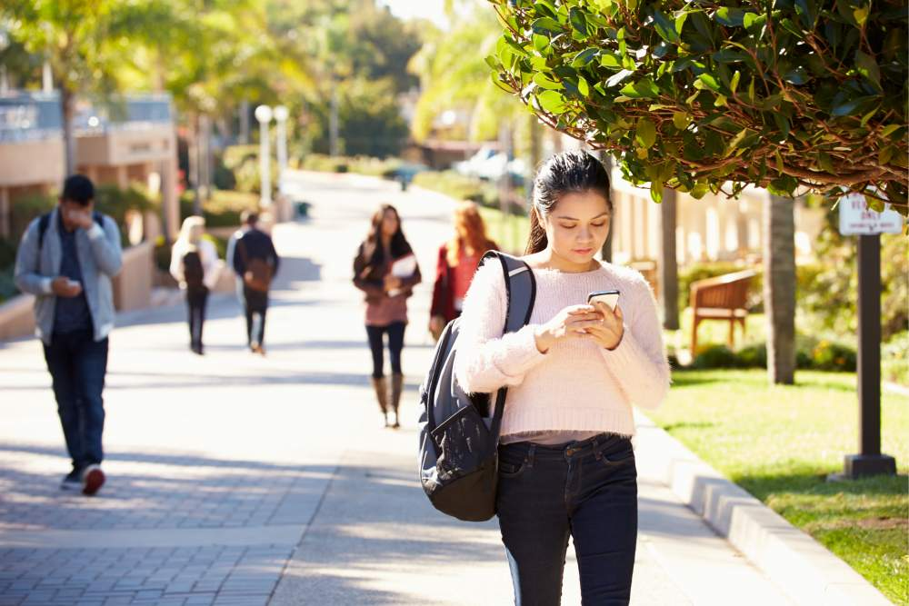 girl on mobile phone at university