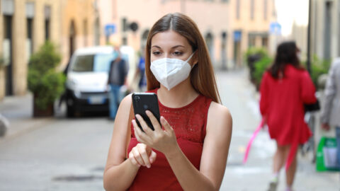 Masked girl with mobile phone